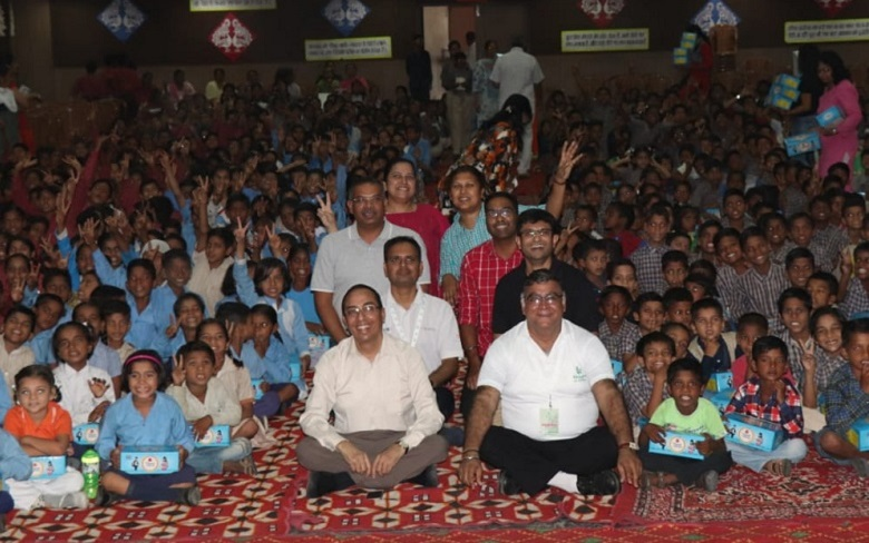 Underprivileged school children in India receive new shoes