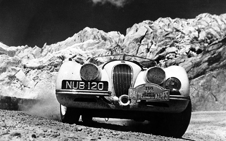 The Jaguar XK120 on Furka Pass, Switzerland during the 1950 Alpine Rally.
